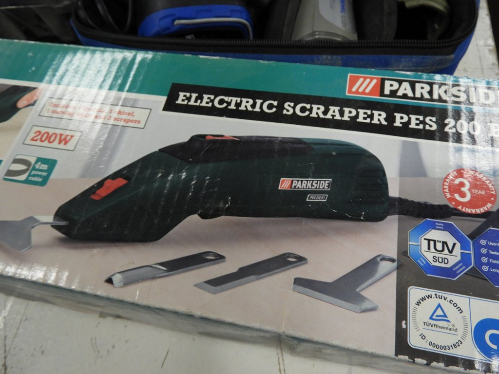 A Dremel 10 8v set, a Parkside PES 200 B1 electric scraper